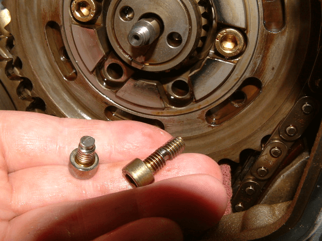 BMW E46 M3 cam bolt wear and failure. Cam bolts should be inspected for wear and replaced before they break.